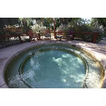 View of pool at Hacienda Hot Springs Inn in Desert Springs, California